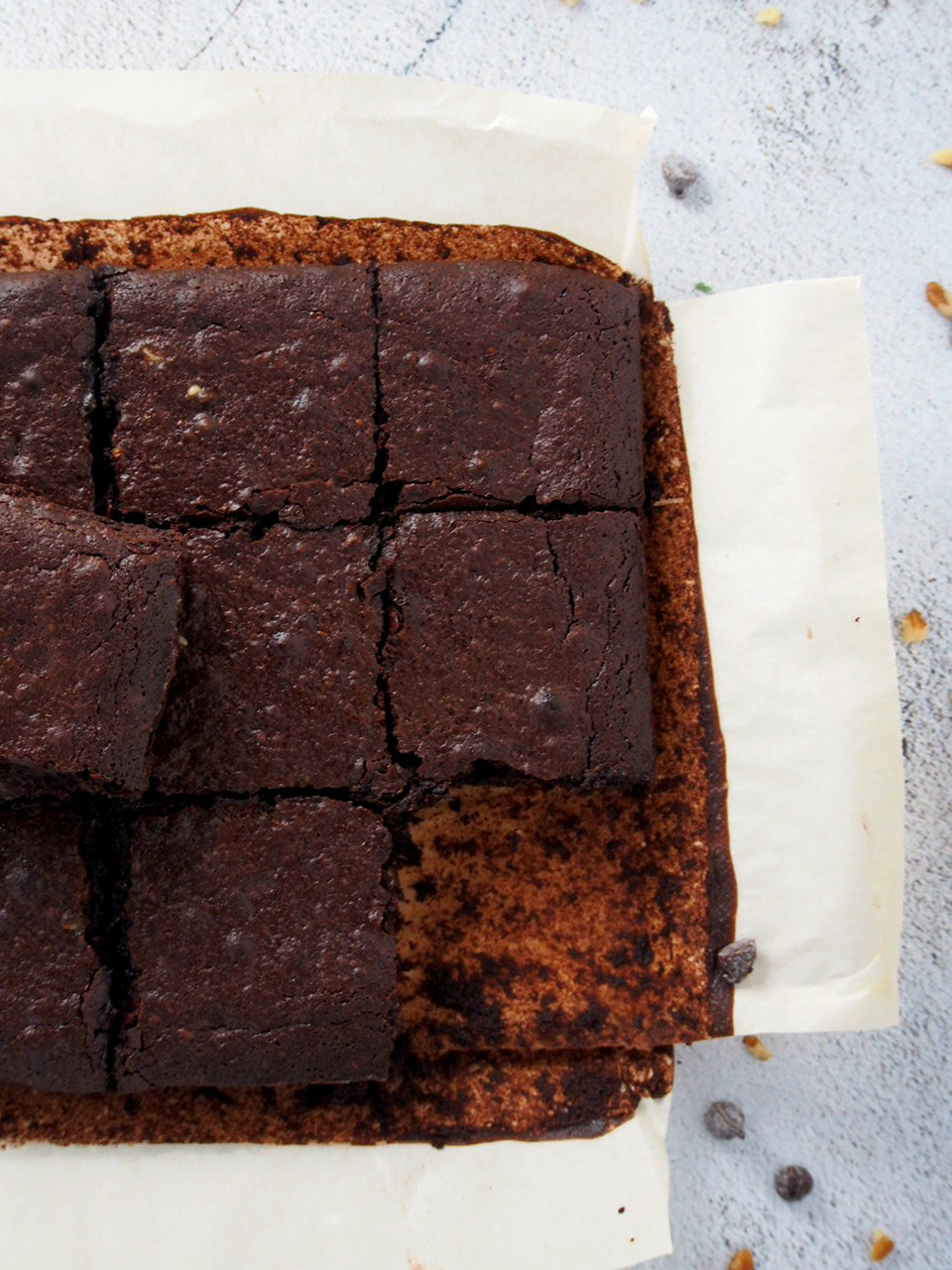 Freshly baked brownies with one square cut put.