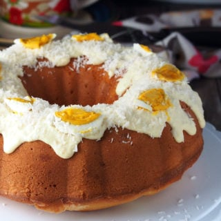 bibingka pound cake-A rich, dense pound cake filled with bits of salted eggs, glazed with a creamy milk frosting, then topped with coconut flakes and more salted eggs.