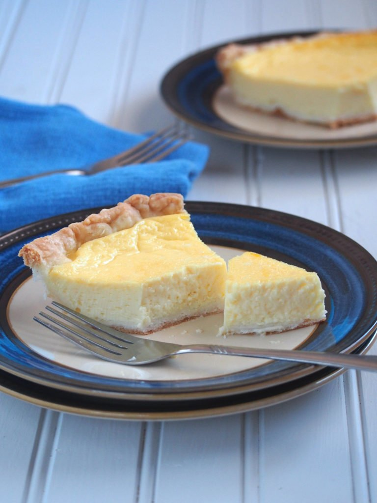 Another slice of egg pie with a part cut with a fork.