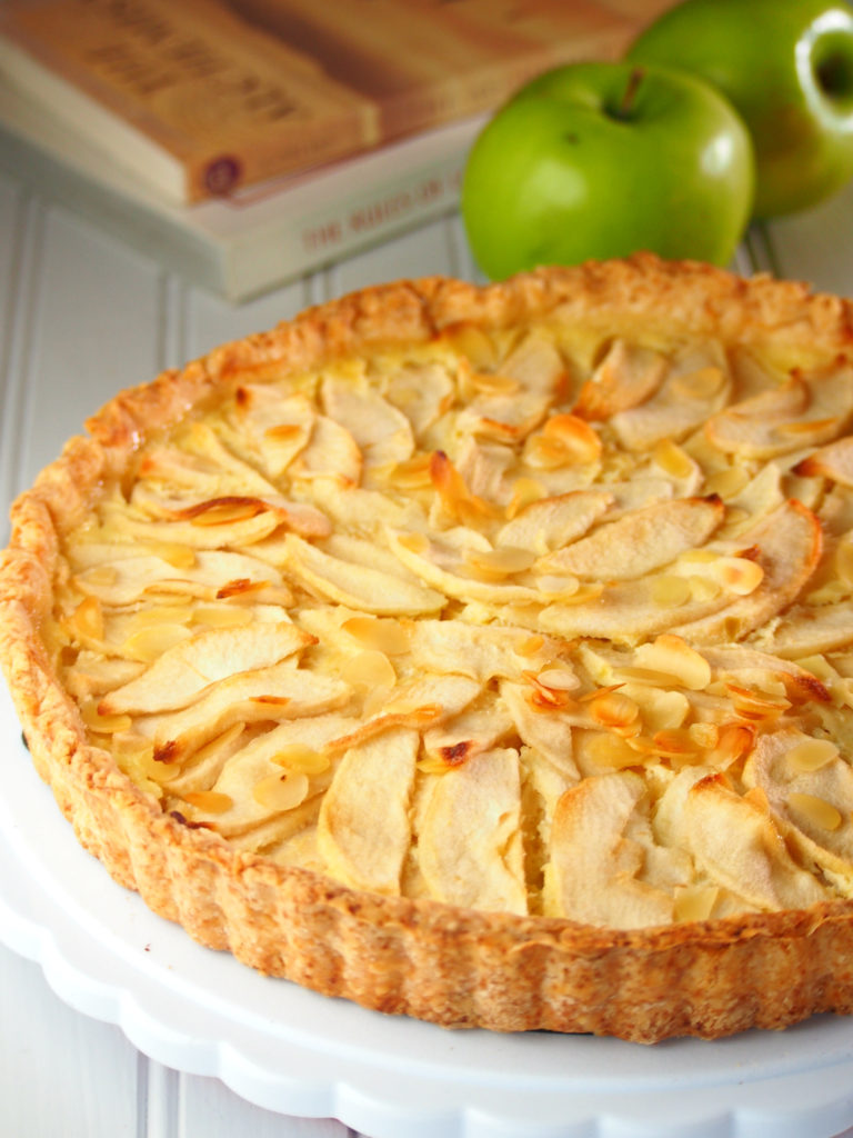 This apple tart is perfect with its tender-crisp apple slices layered over a bed of a creamy and cheesy vanilla custard.