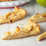 This Apple tart is a delightful dessert made with crisp apples on a bed of creamy vanilla cream cheese layer.