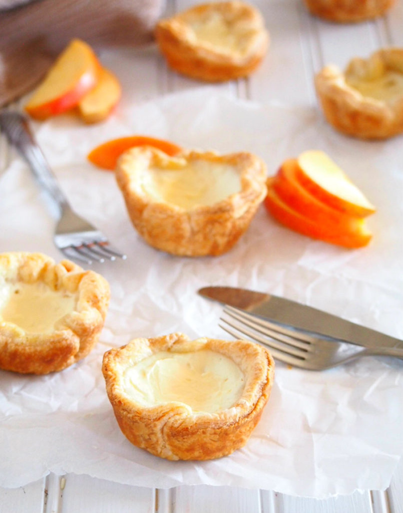These delightful egg tarts are made of cheesy and creamy egg whites custard and nestled into light, flaky and buttery puff pastry crusts. These little treats are delicate, melt in your mouth bites with a very buttery crisp touch from the puff pastry.