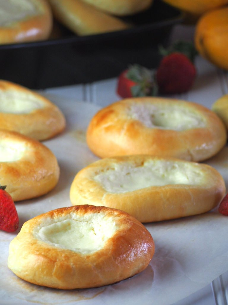 Cream cheese brioche are buteery and rich brioche filled with leminy cream cheese in the center.