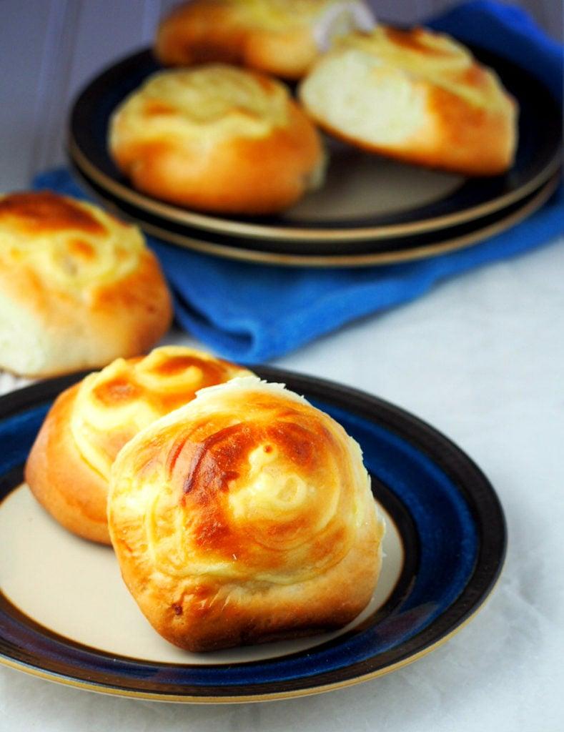 Custard buns are soft milk bread filled with creamy custard in the center.