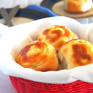 Custard buns are soft milk bread filled with creamy custard filling in the center.