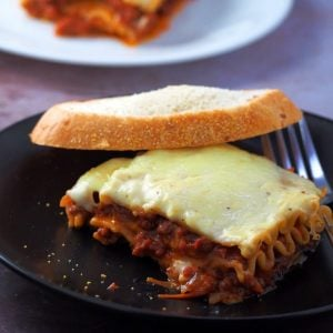 Lasagna slice on a serving plate.