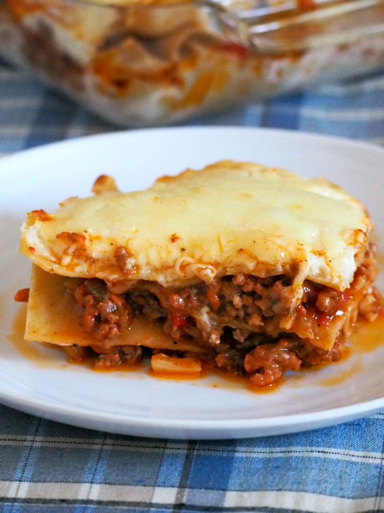Filipino Style Lasagna is sweet, cheesy and creamy. It is a rich lasagna pasta made with saucy ground beef meat sauce. layered with a creamy bechamel sauce, and finally topped with lots of mozzarella cheese.