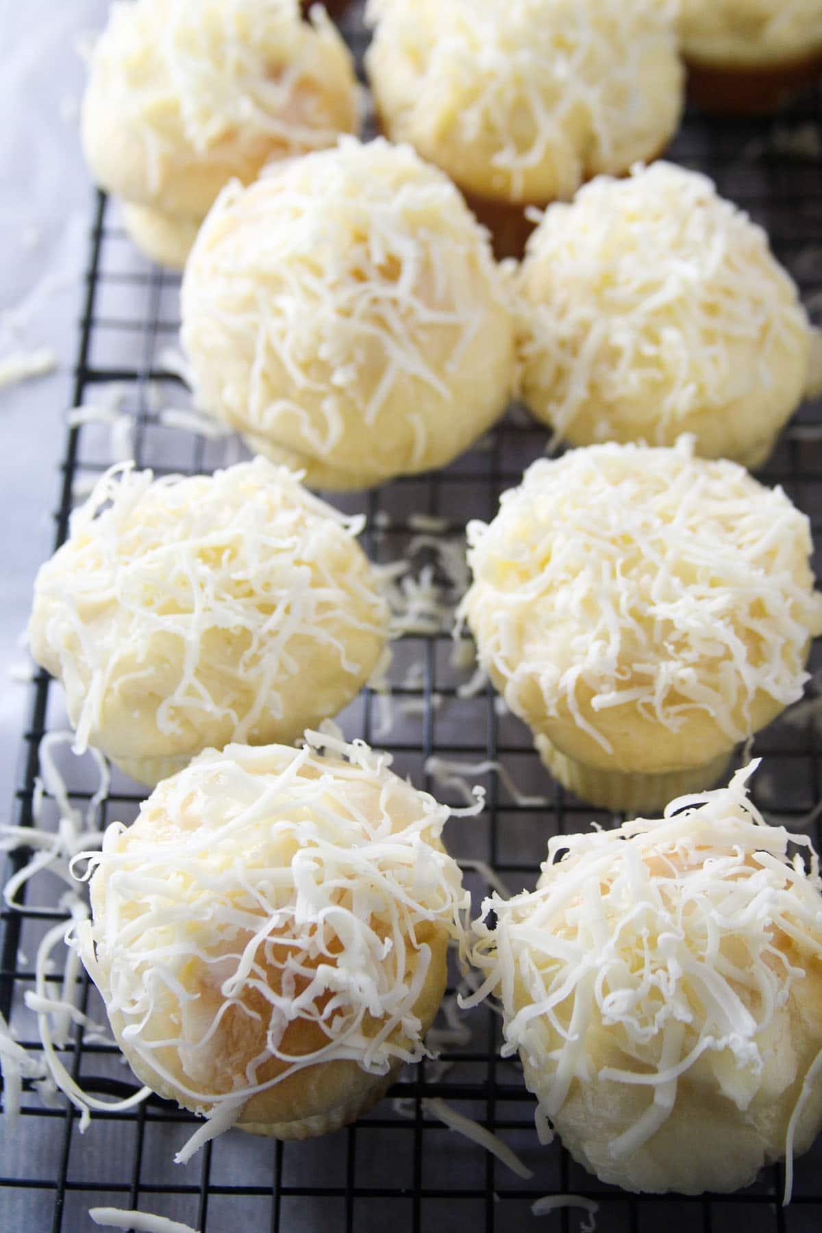 Ensaymada on a cooling rack.