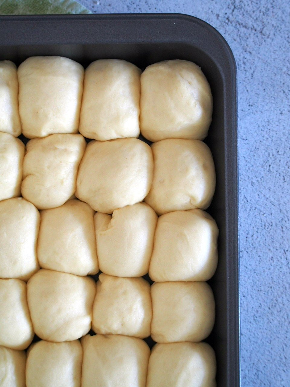 The shaped Hawaiian Rolls dough, risen and ready for baking.