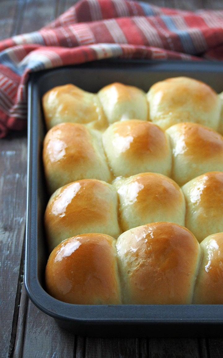 Freshly baked honey buns brushed with honey butter glaze.