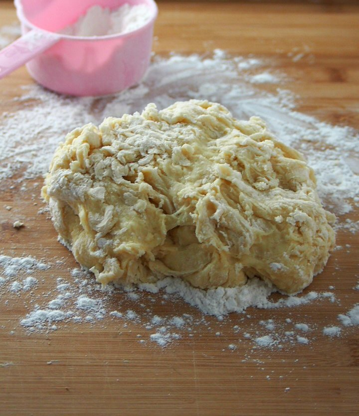 The dough for honey buns coming together after the initial mixing and ready to be kneaded.