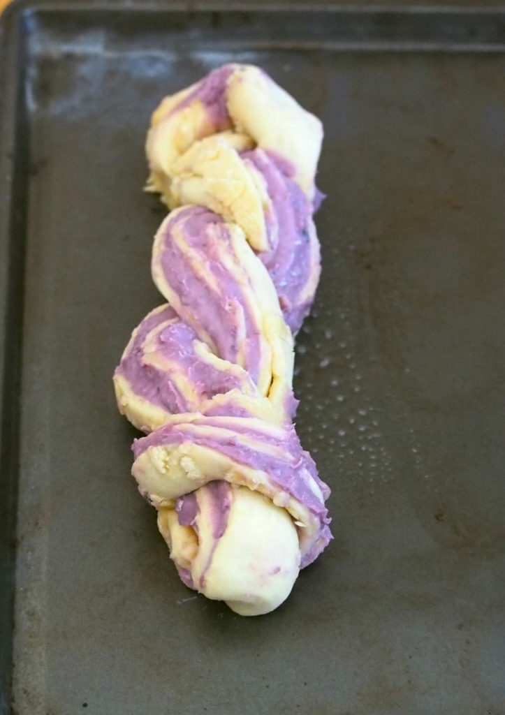 The softness of the brioche, and the creamy, buttery ube (purple yam) filling make these ube ensaymada amazing out of the oven. Make this pretty braided ube ensaymada and impress your guests with a lovely pastry centerpiece.