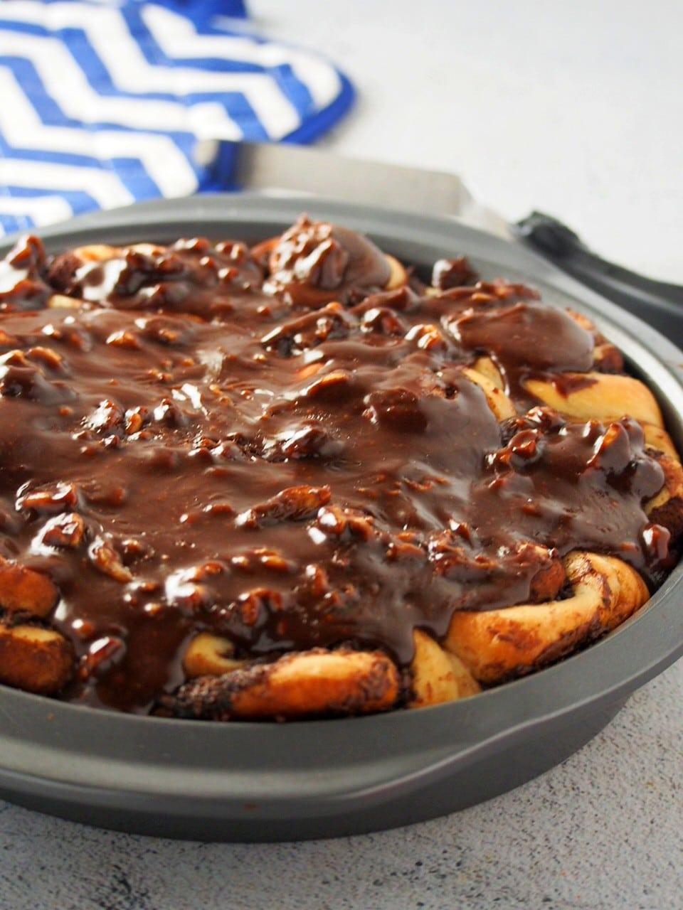 Fresh Nutella rolls on the baking pan.