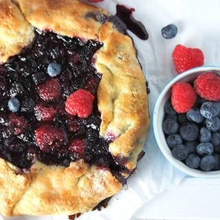 Juicy sweet berries are nestled in a crisp cornmeal crust in this simple mixed berries galette. Top this with vanilla ice cream and you are in for a sweet, lightly tart and crisp pastry treat!