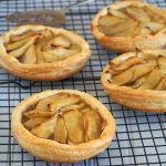 This Caramelized Apple Tarts are made of succulent and sweet apples that are nestled on a bed of chunky pecan paste. They are piled on a buttery puff pastry for a delightfully, tender crunch.