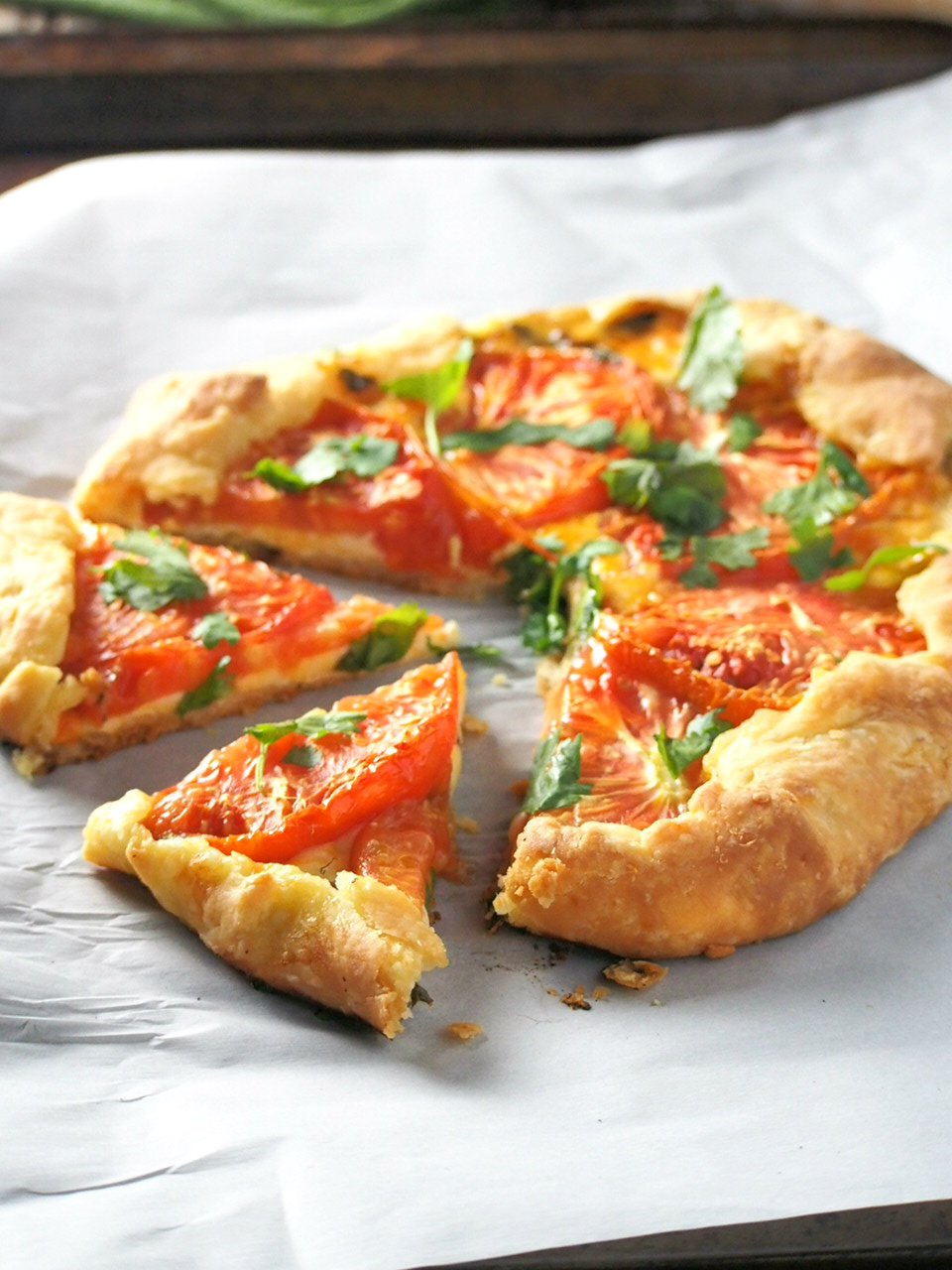 Serve this Cheese Tomato Galette as a snack or as a light meal and delight your guests with the appetizing combination of tomato and cheese enclosed in a crisp and flaky pastry.