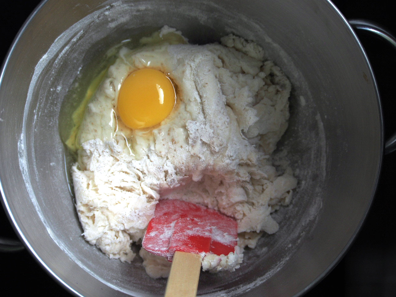 The egg is added to the dough.