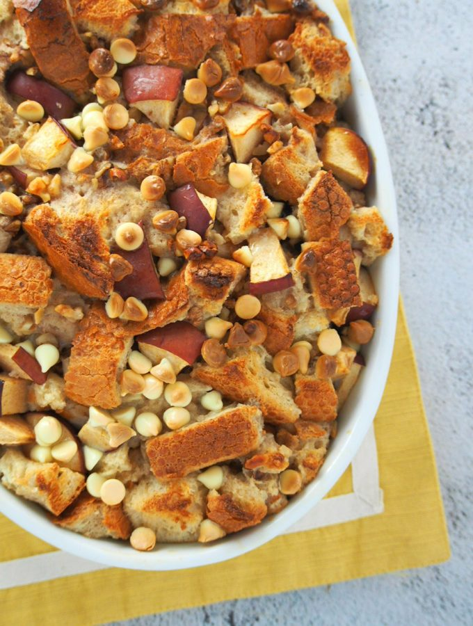Really delicious cinnamon apple bread pudding is a dessert that will warm up and sweeten your day. Apples, nuts, cinnamon and chocolate chips, this is a comforting treat! #apples #cinnamon #breadpudding | Woman Scribbles