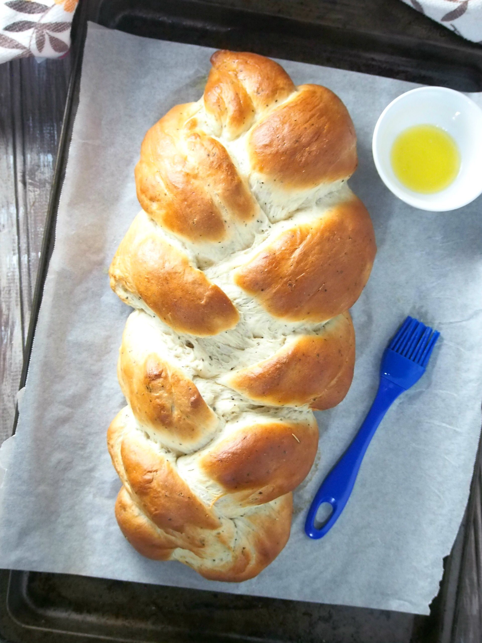 Garlic Herb Bread is a tasty braided loaf that is infused with herbs and full of savory garlic flavor. Serve this as a side along with your meal or alone as a filling snack.
