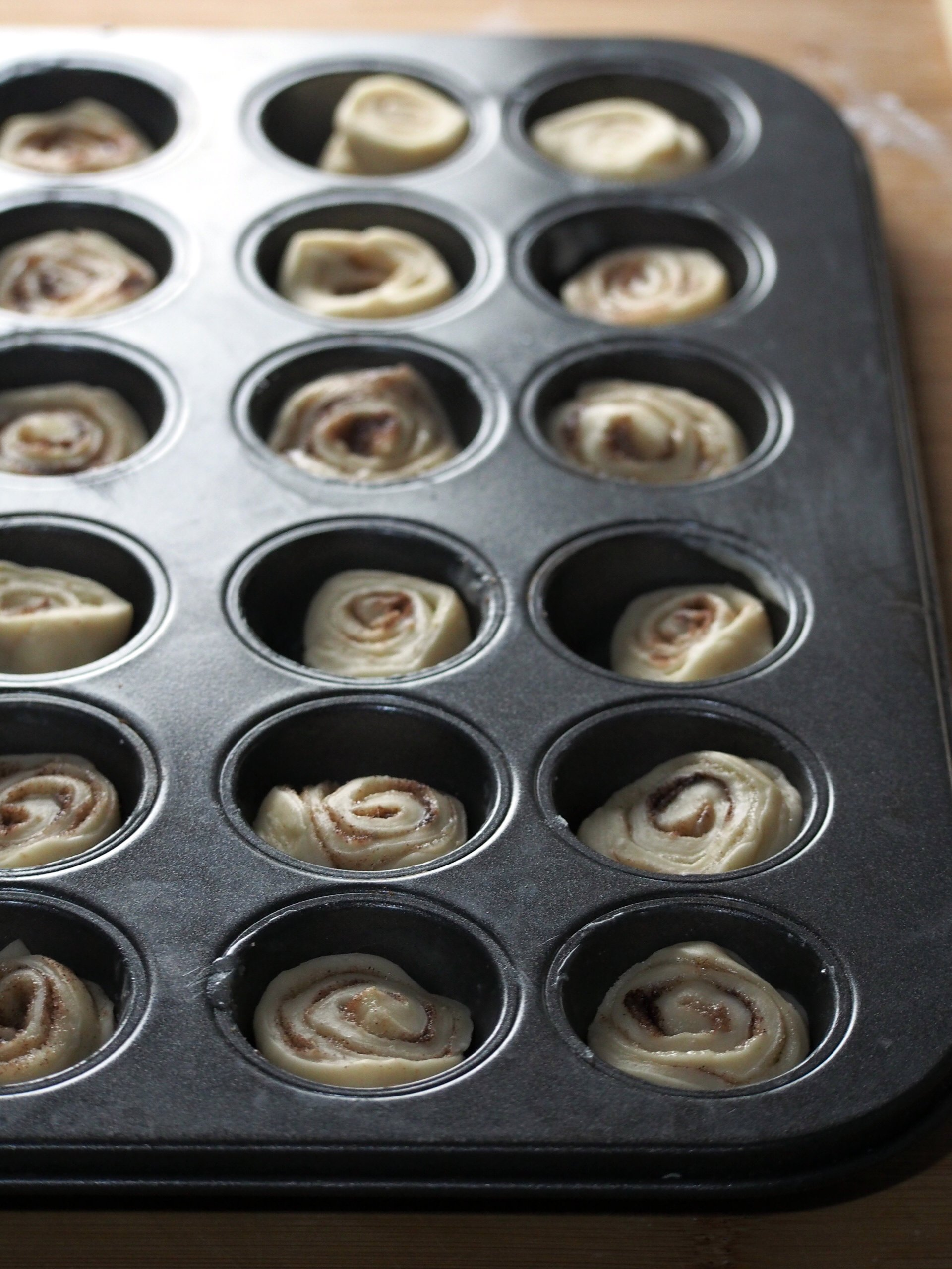 Letting the assembled dough rise in a mini muffin tin.
