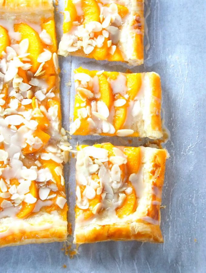 This peach tart is a delicious and easy peach dessert recipe hat uses read-made puff pastry and yields a fresh, butter and flaky pastry dessert.