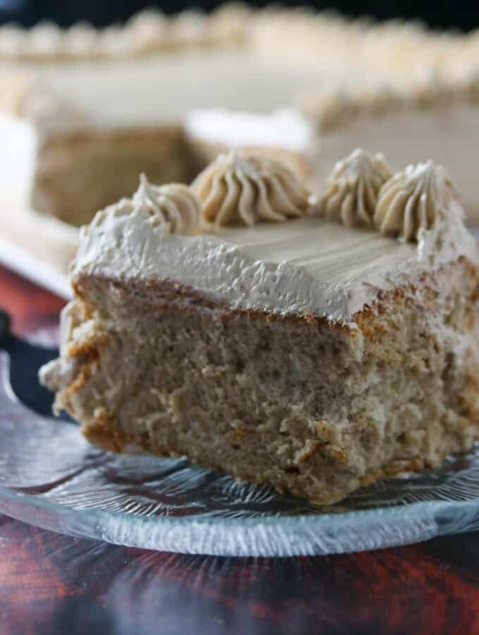 A slice of mocha cake on a small plate.