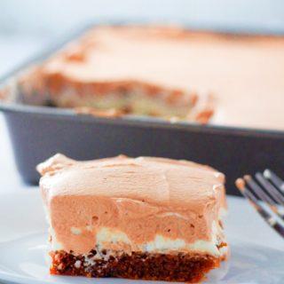 Close up shot of a slice of Ovaltine Cake.