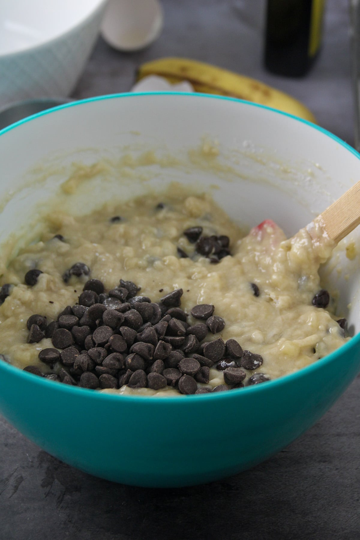 Folding in the chocolate chips into the banana bread batter.