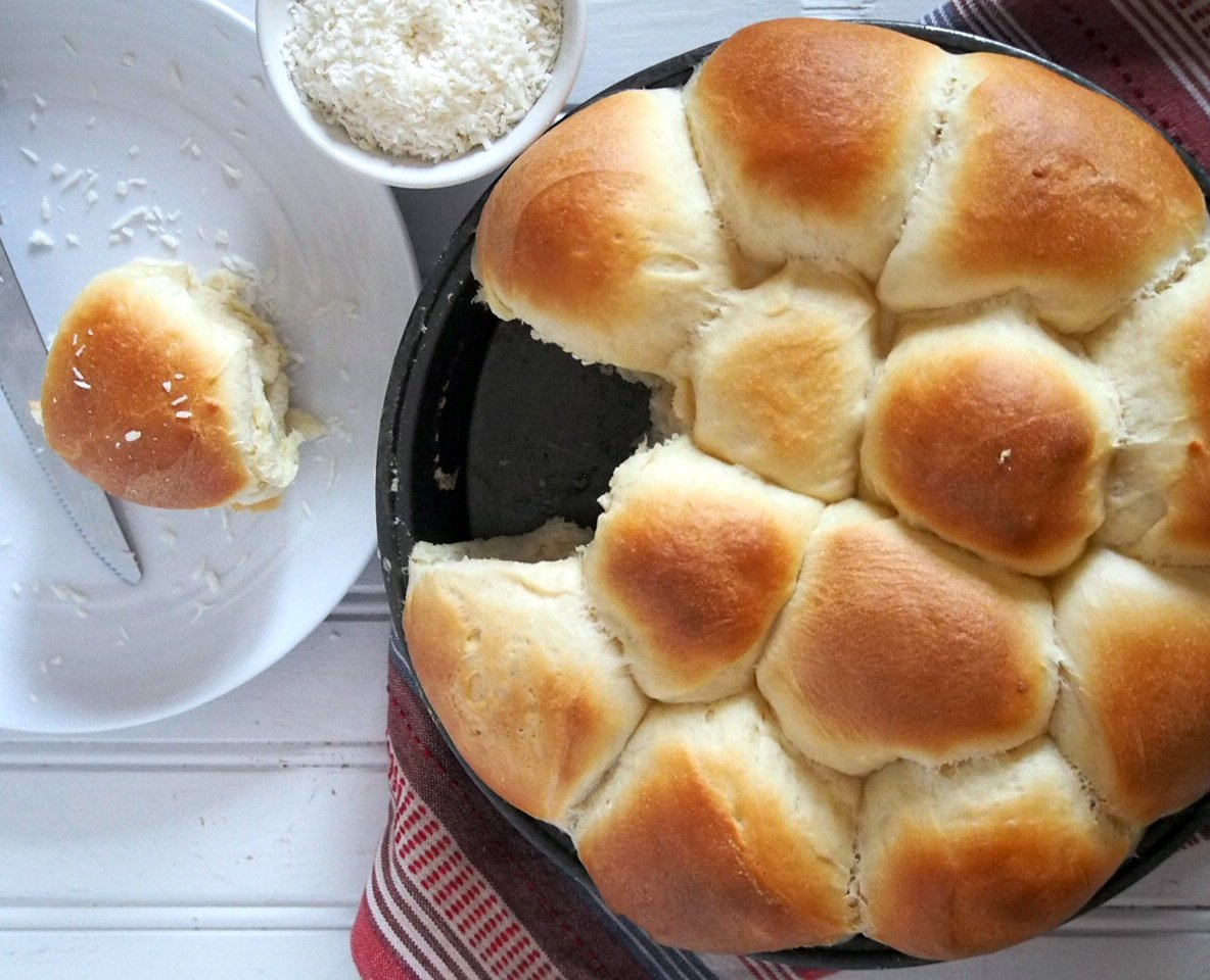 These Coconut Bread are sweet buns baked in glorious coconut milk and turn out as tasty, delicate and moist. You are going to pull out a piece one after another.