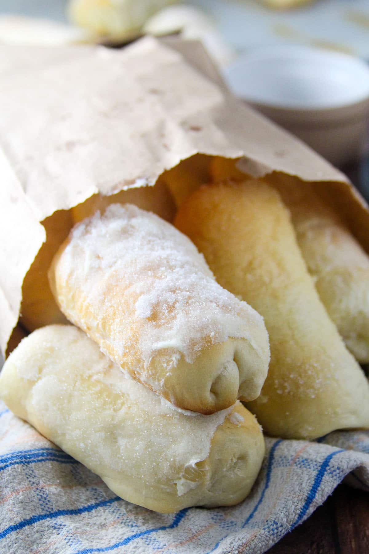 Sweet cheese rolls peeking thru the brown bakery bag.