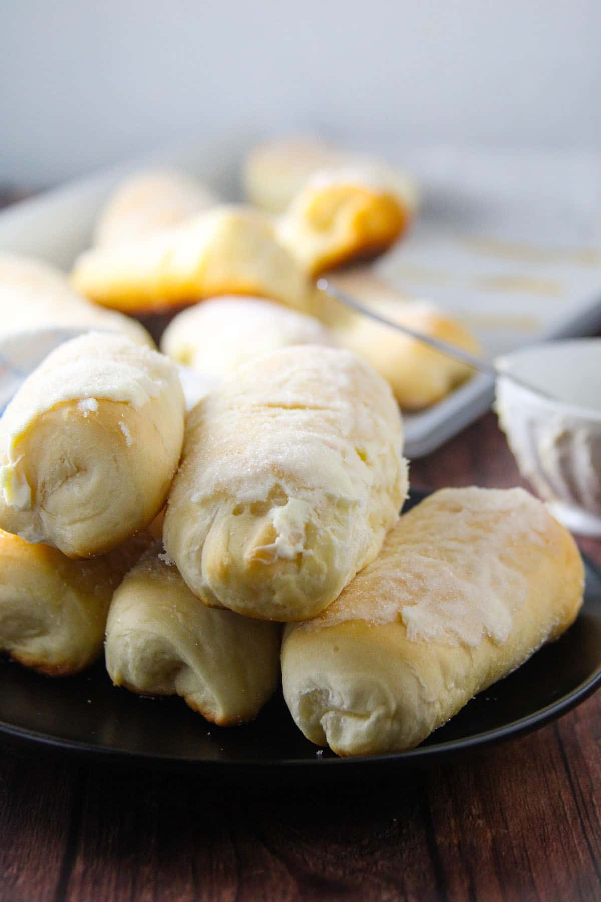 Sweet cheese rolls arranged on a small plate.