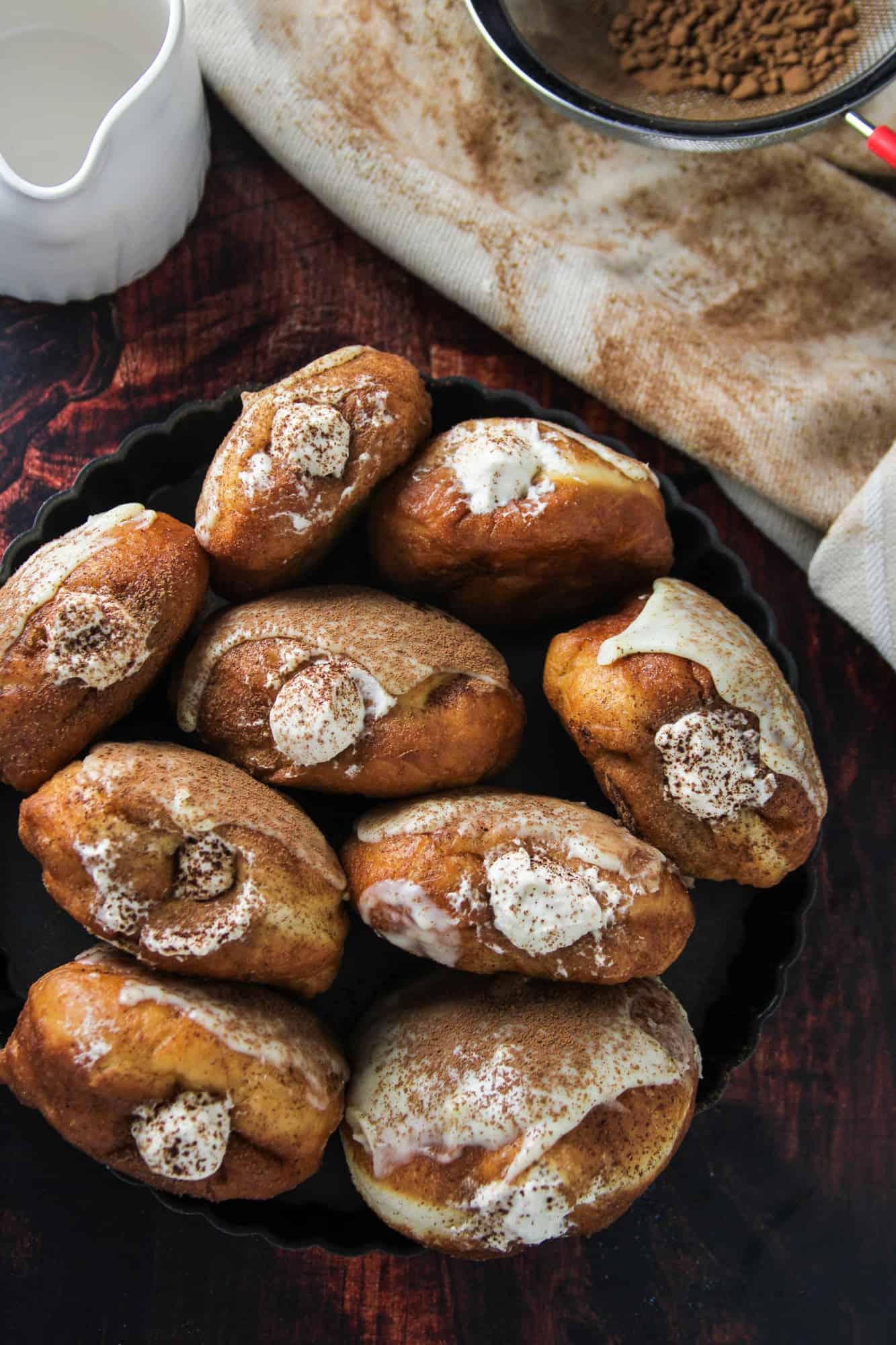 Top shot of Tiramisu Donuts arranged in a circle pan.