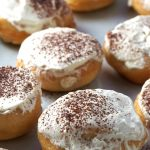 Enjoy your tiramisu in these soft and airy yeast donuts. Tiramisu Donuts are filled with light coffee cream and dusted with cocoa powder. These are your indulgent breakfast or your afternoon treat with a cup of tea.