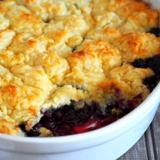 Blueberry cobbler with a scooped part on the front side.