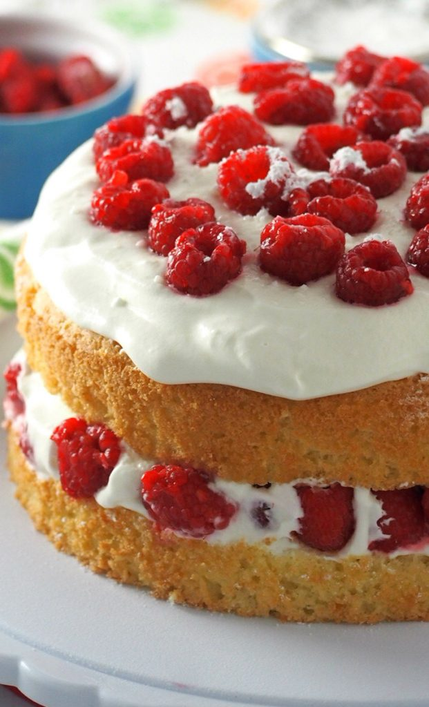 This luscious raspberry cake is filled with fresh berries and a lightly indulgent whipped cream. It is a light, heavenly cake perfect for celebrations or even as a daily light dessert.