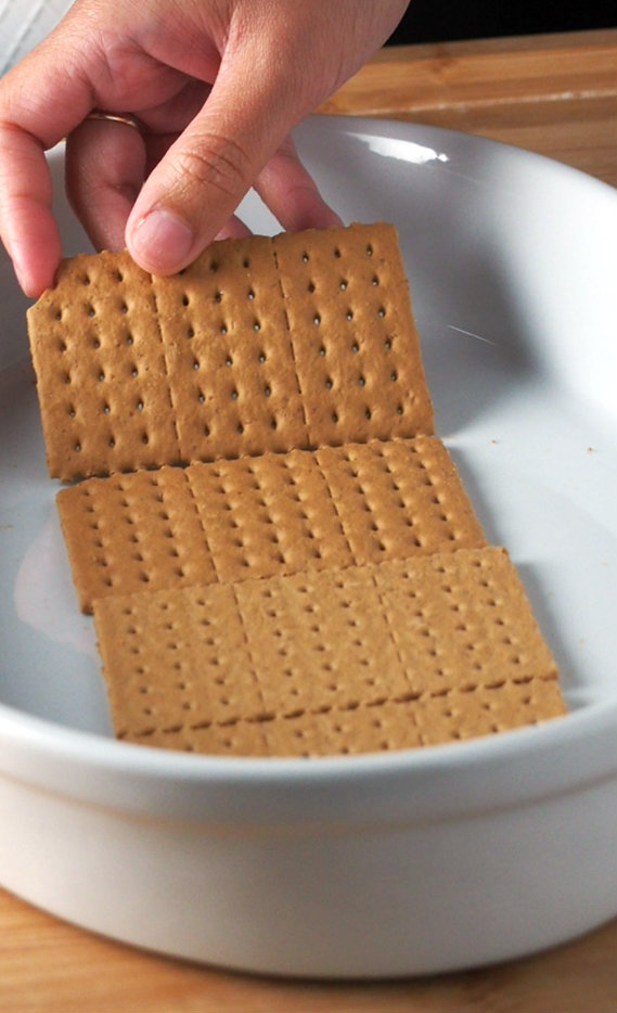 Arranging 4 pieces of graham crackers to form the base of the banana split icebox cake.