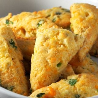 Cheesy and buttery with a good savory flavor, these Cheese Scones with Scallions are a nice treat for your breakfast or as a side dish to your meal.