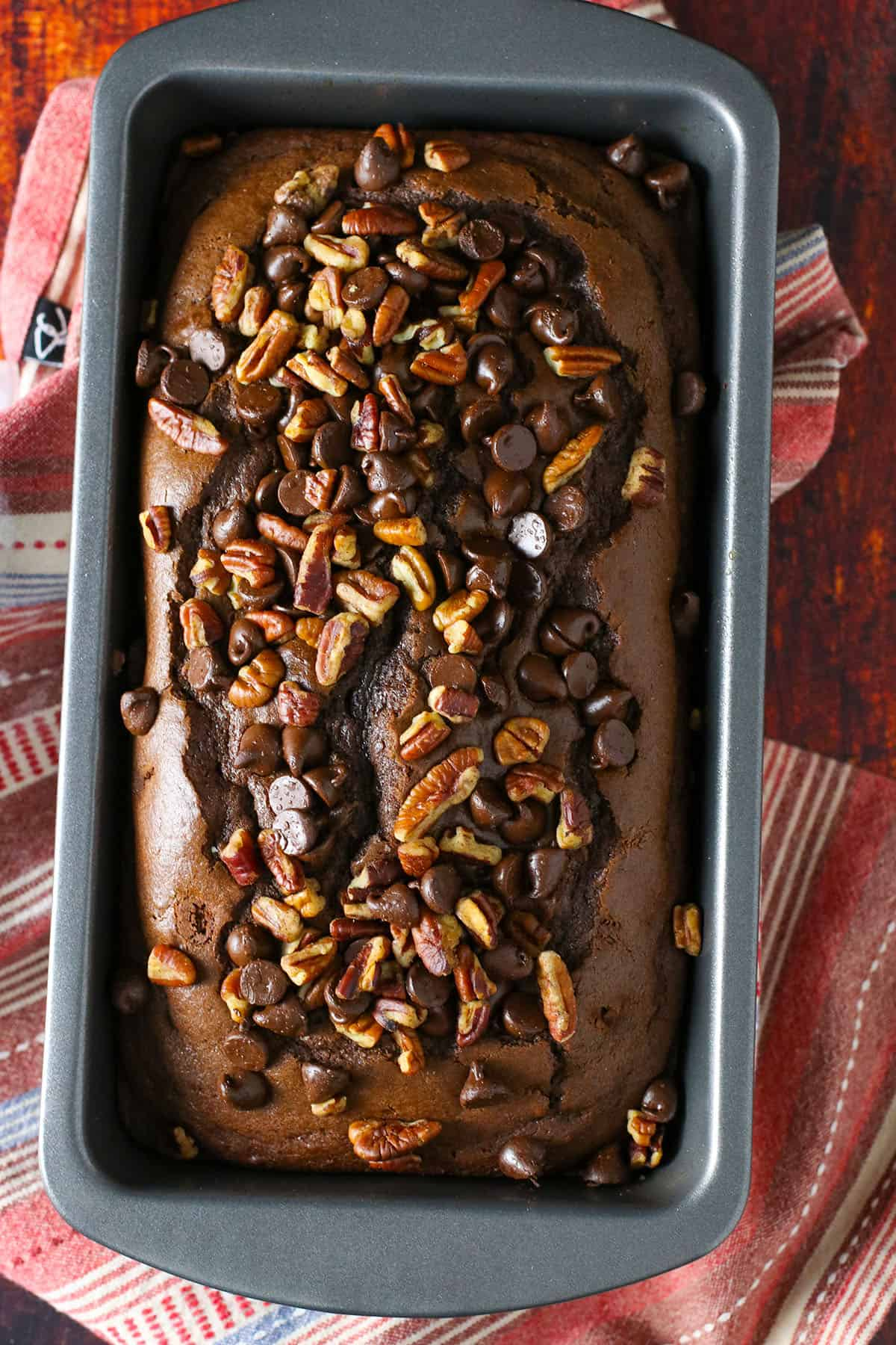 Top shot of chocolate chip loaf bread in a pan.