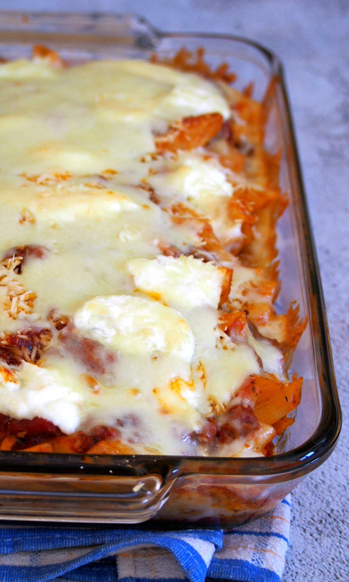 Meaty, tasty and cheesy, You will love this simple Baked Ziti for a hearty meal that the whole family will enjoy!