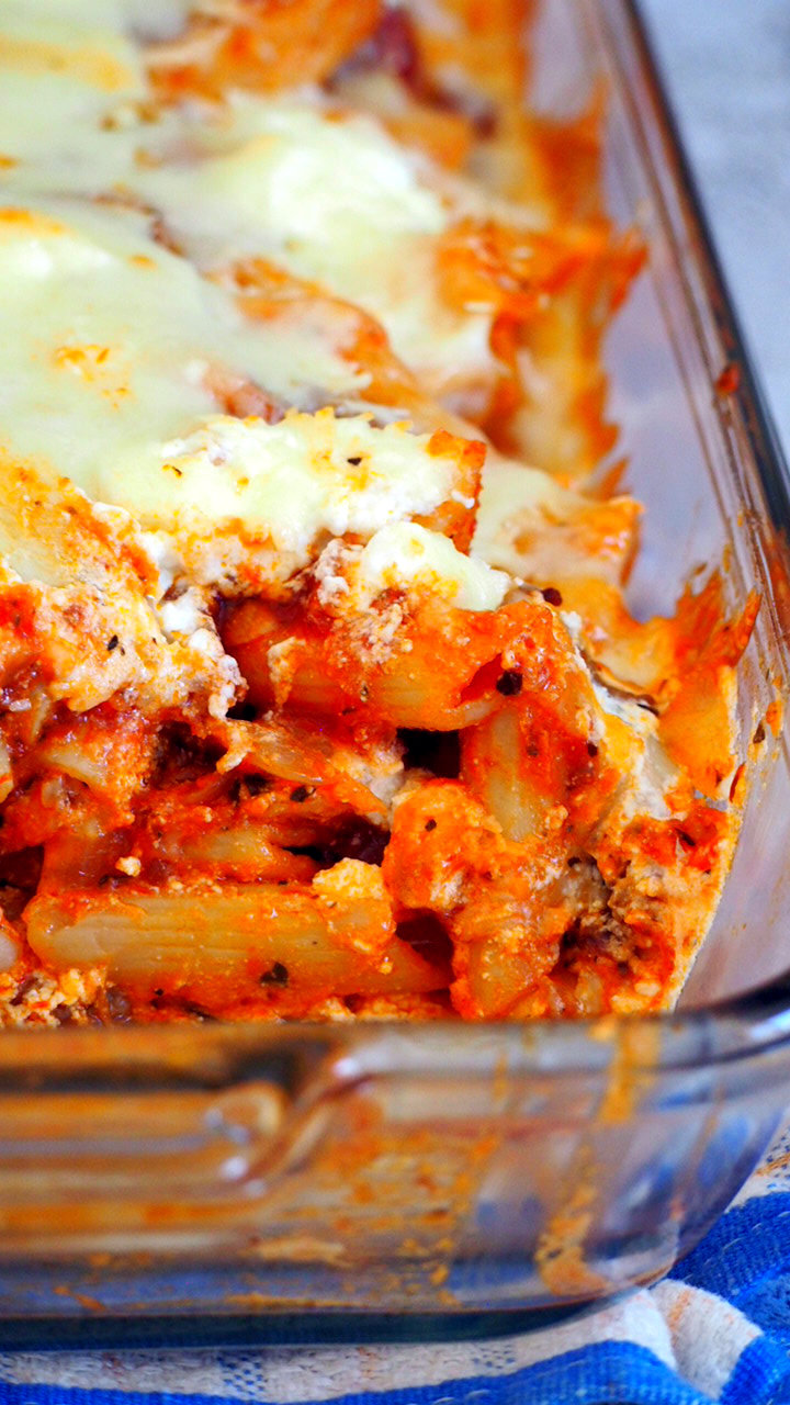 Baked Ziti with a part scooped out from the side, showing the tasty interior.