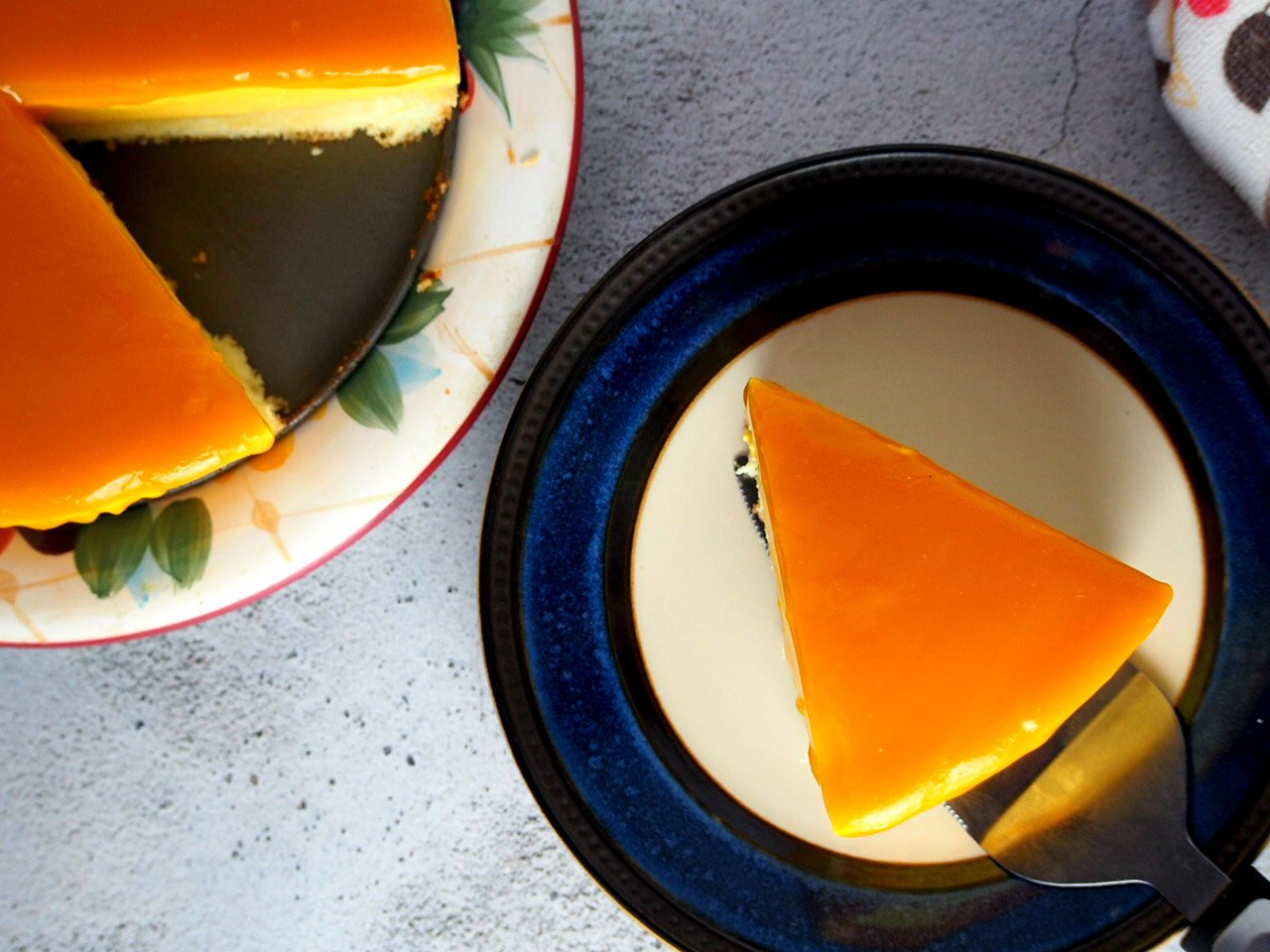 Top angle shot of a slice of mango mousse cake.