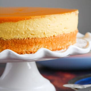 Mango Mousse Cake on a cake stand.