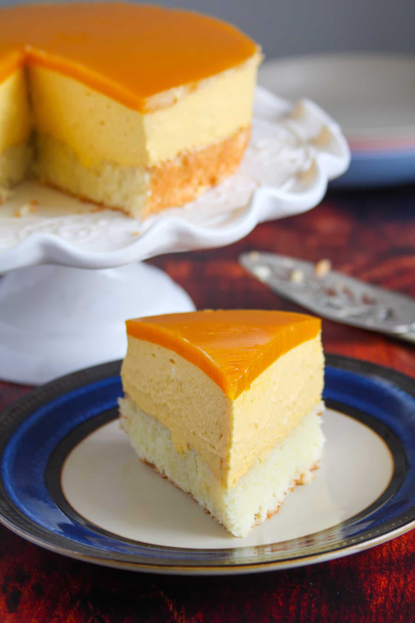 A slice of mango Mousse cake on a plate