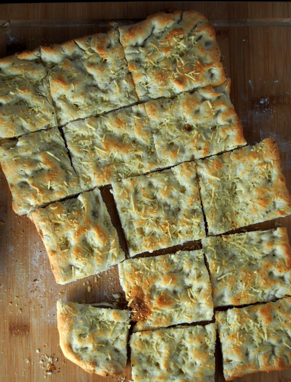 Top angle of focaccia bread sliced into rectangles.