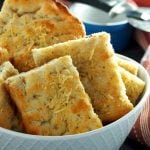 Focaccia bread sliced into rectangles and arranged in a bowl.