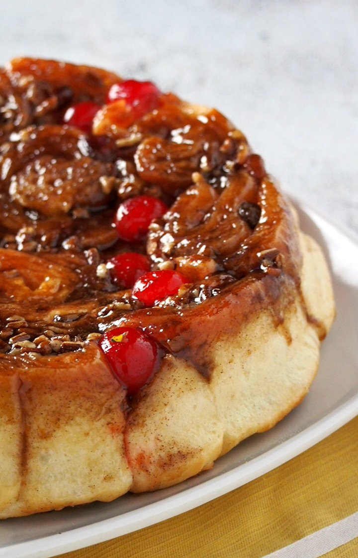 Chelsea Buns are your festive, colorful cinnamon rolls with all the delightful add-ons like raisins, pecans and cherries.