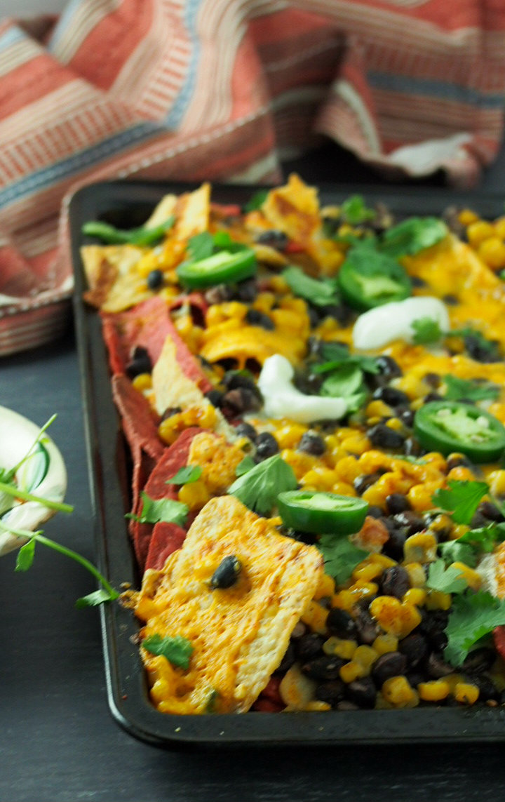 Shot of the Sheet pan bean and corn nachos taken on almost eye level view.