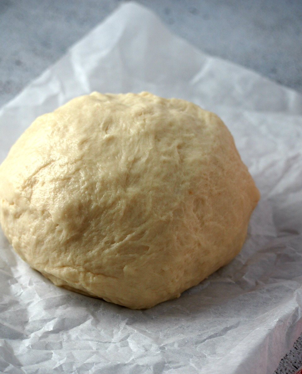 The kneaded beehive buns dough shaped into a ball and ready for proofing.