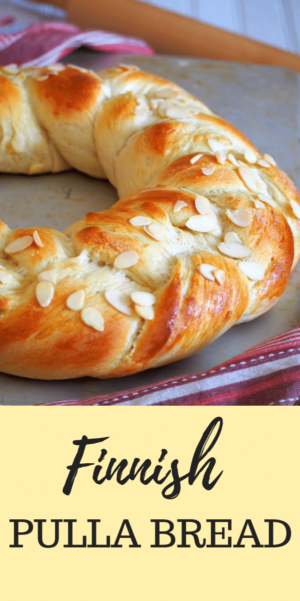Finnish Pulla is a celebration bread braided beautifully like a wreath. It gets its nice flavor from the cardamom and it is adorned with crunchy almonds as finishing on top. #pullabread #pullarecipe #braidedwreathbread
