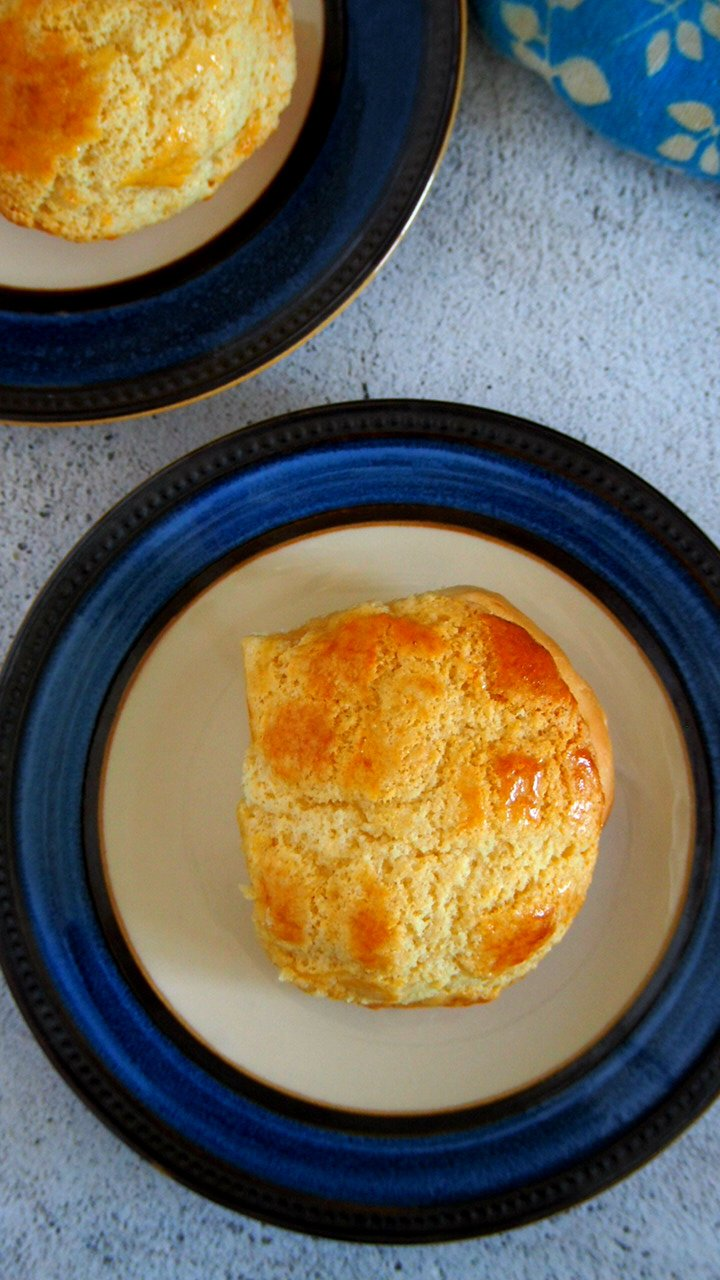 Top angle shot of a pineapple buns on a saucer plate.